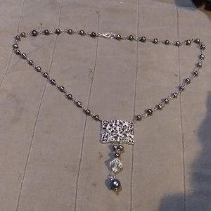 Fresh water black pearl necklace.